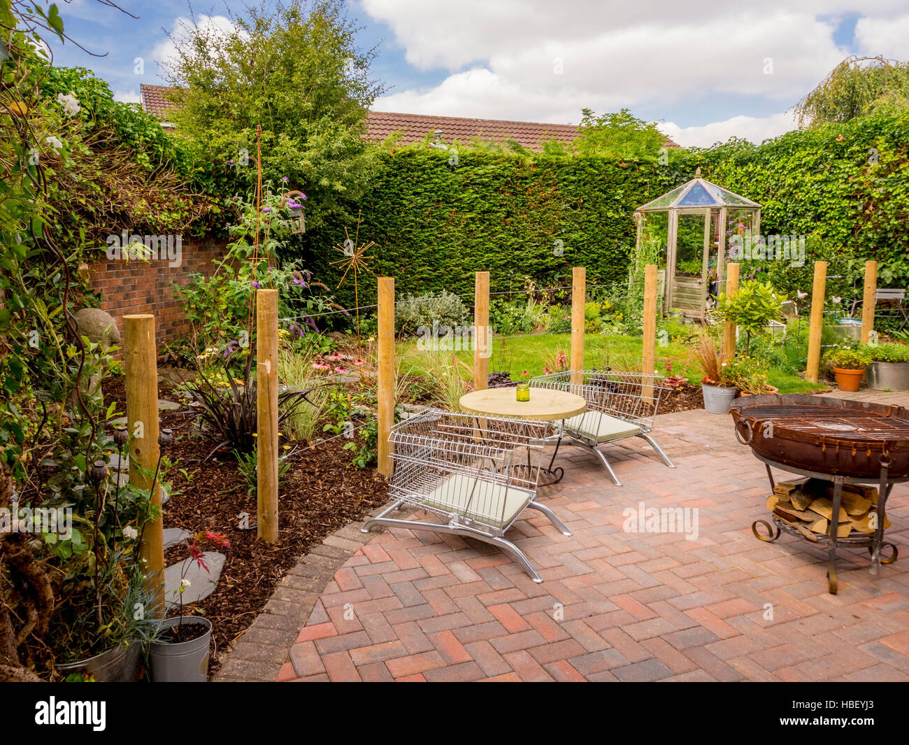 Garden Areas Divided Using Wooden Stakes To Create Outdoor Rooms In Modern  Contemporary Design   Stock