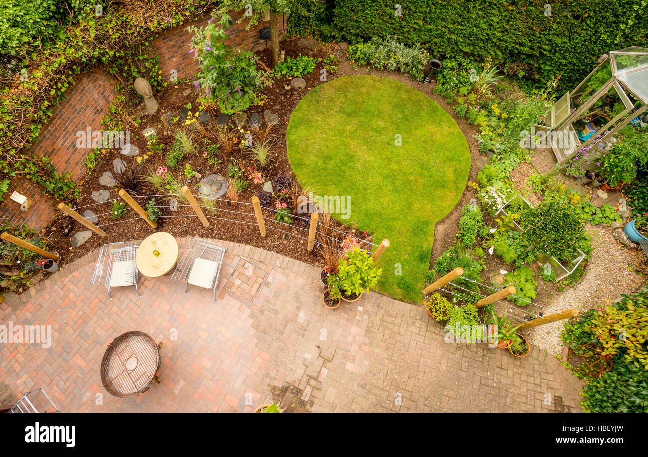 Modern garden seen from above with circular lawn and block paved patio Stock Photo