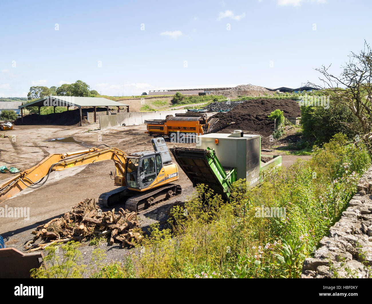 outdoor biomass recycling facility with machines - Stock Image