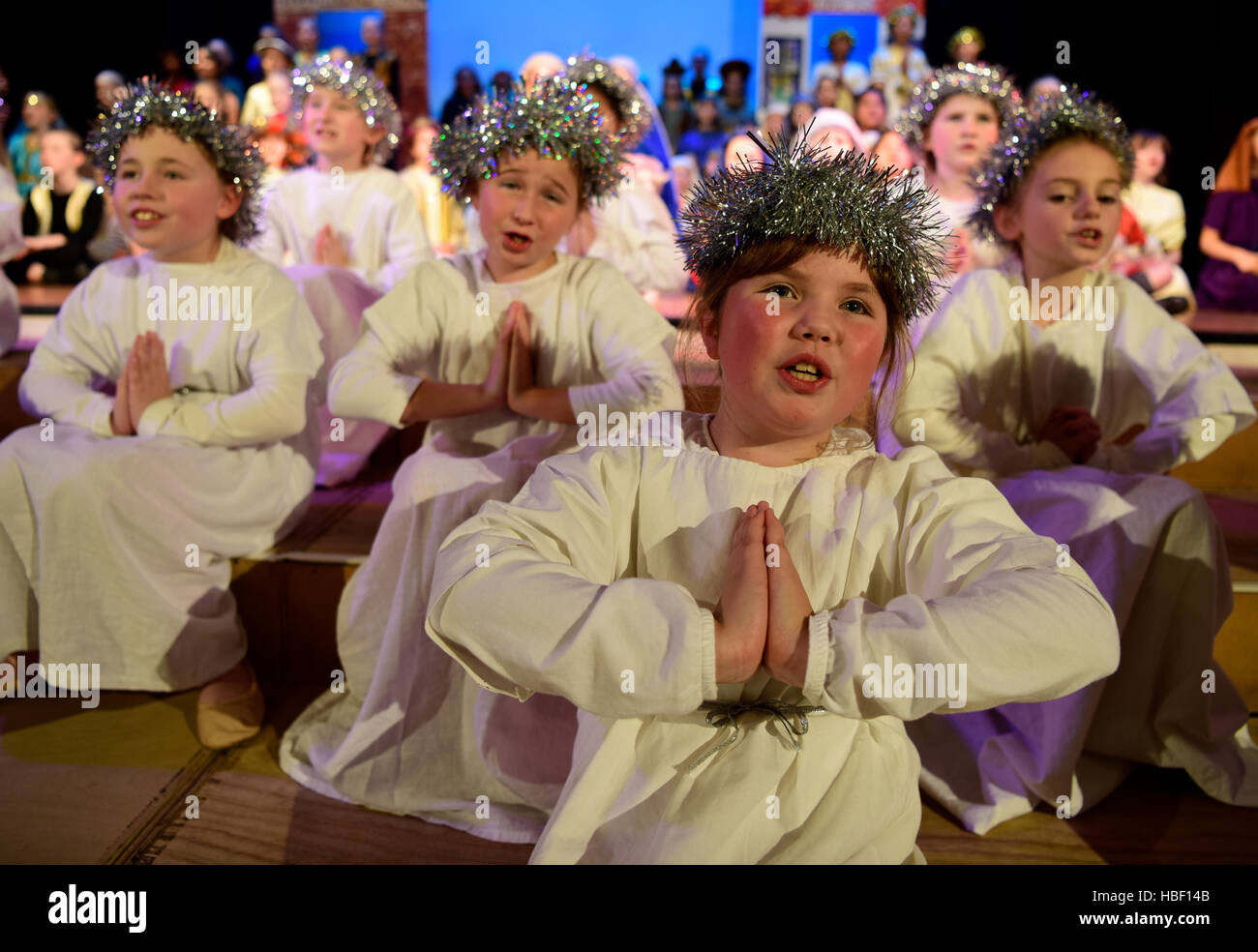 Junior school pupil's in a scene from their 2016 Christmas school play, Hampshire, UK. - Stock Image