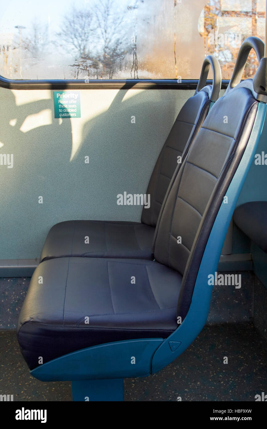 priority seats on a bus for disabled customers in the uk - Stock Image