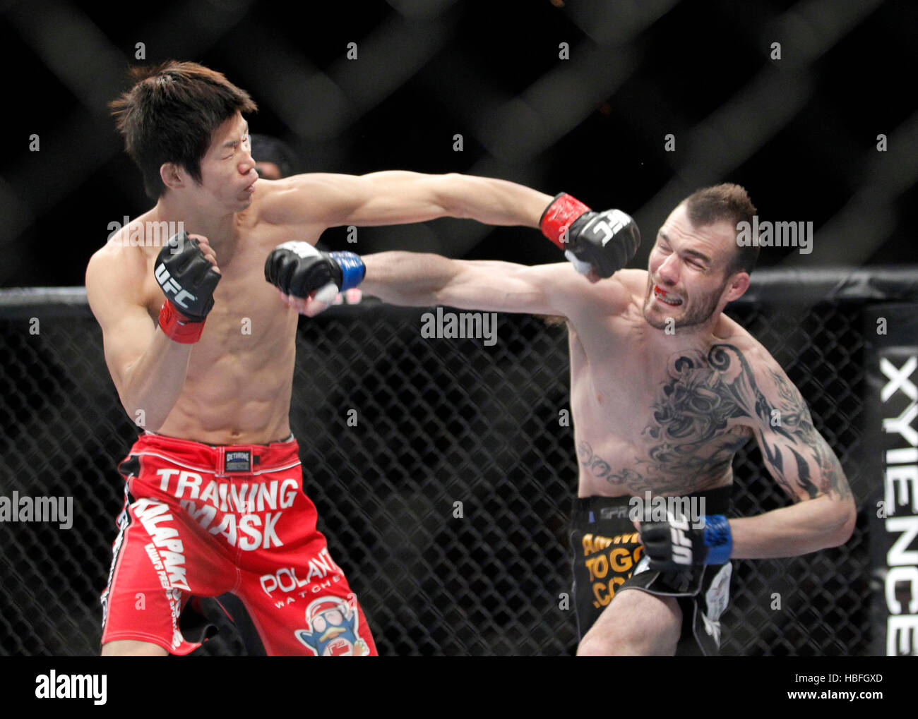 Hatsu Hioki, left, trades punches with George Roop during UFC 137 at
