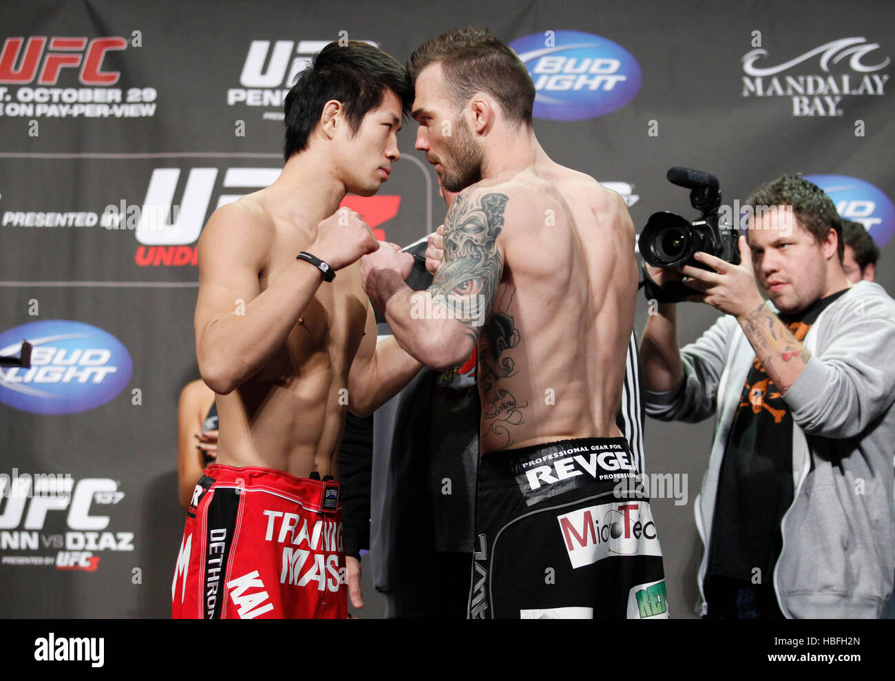 UFC fighters Hatsu Hioki of Japan, left, and George Roop square off