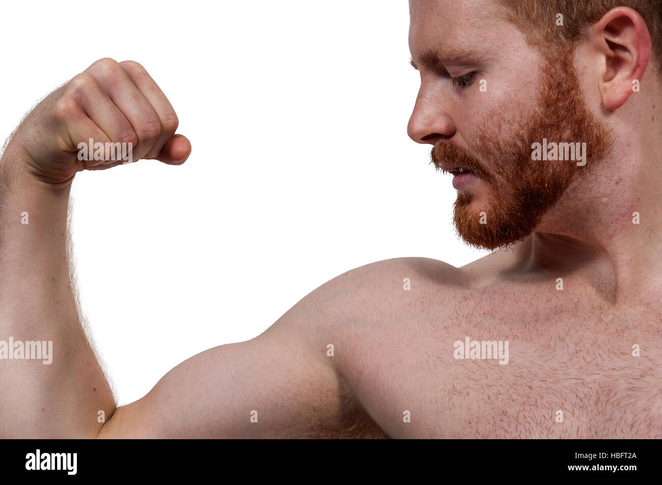 Man Flexing Muscles - Stock Image