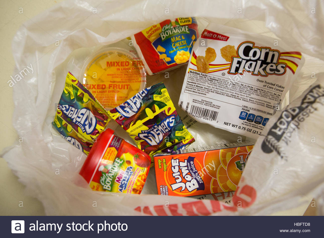 Bags of donated food provided by the national BackPack Program provides food for kids to take home on the weekends. - Stock Image