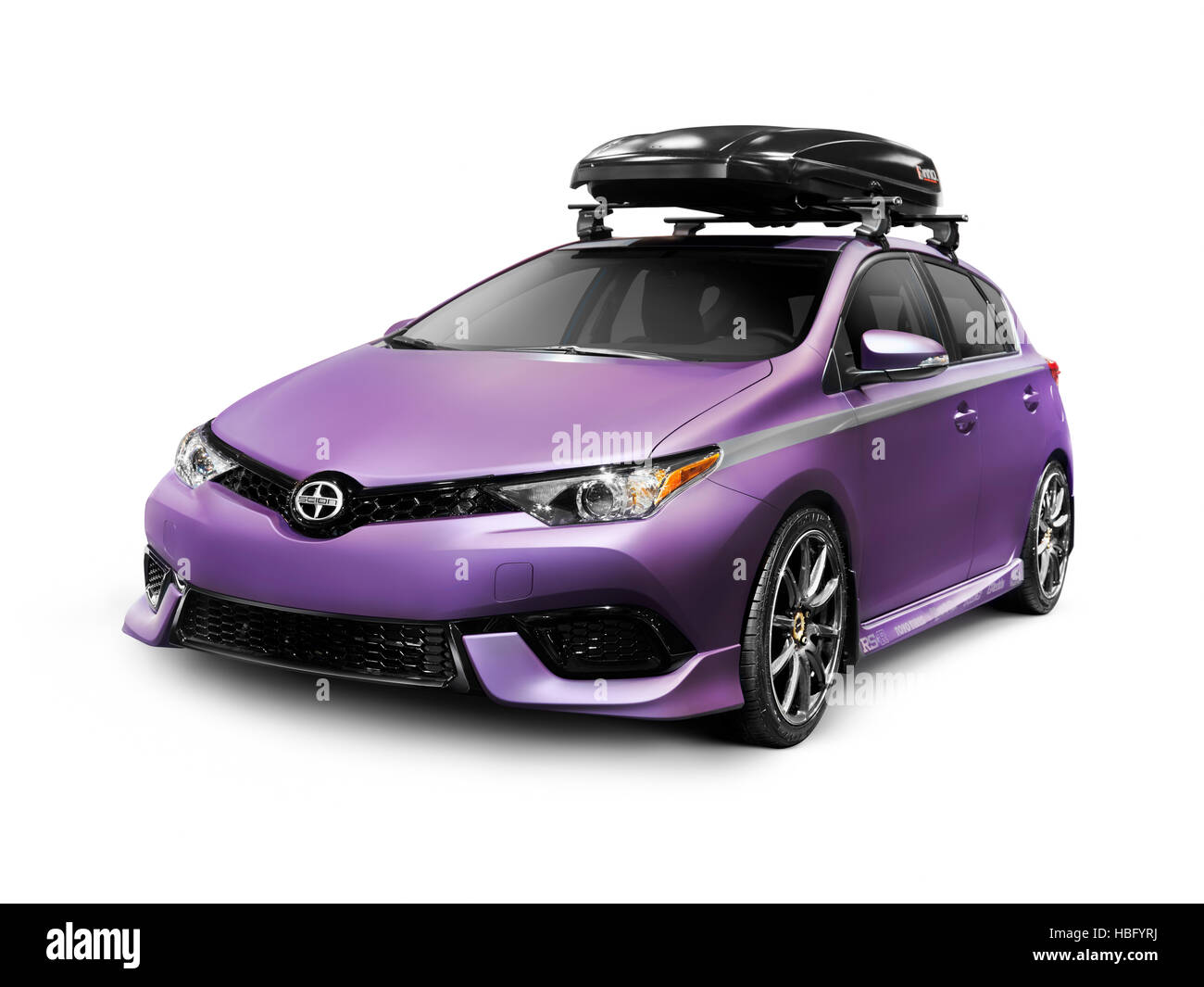Purple 2016 Scion iM affordable small city car with roof rack cargo box isolated on white background Stock Photo
