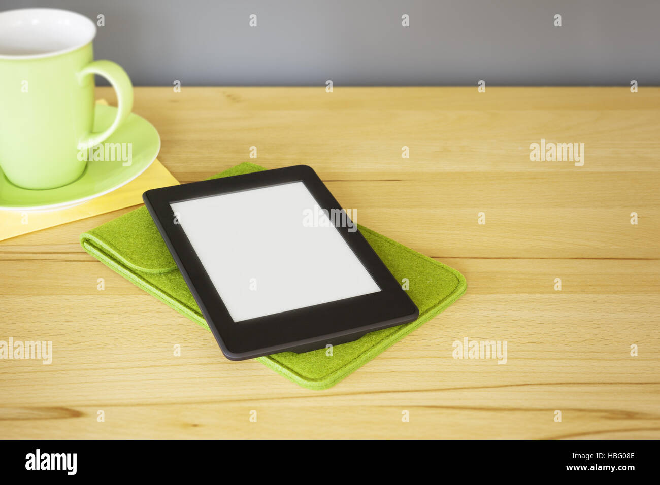 ebook reader on a wooden table - Stock Image