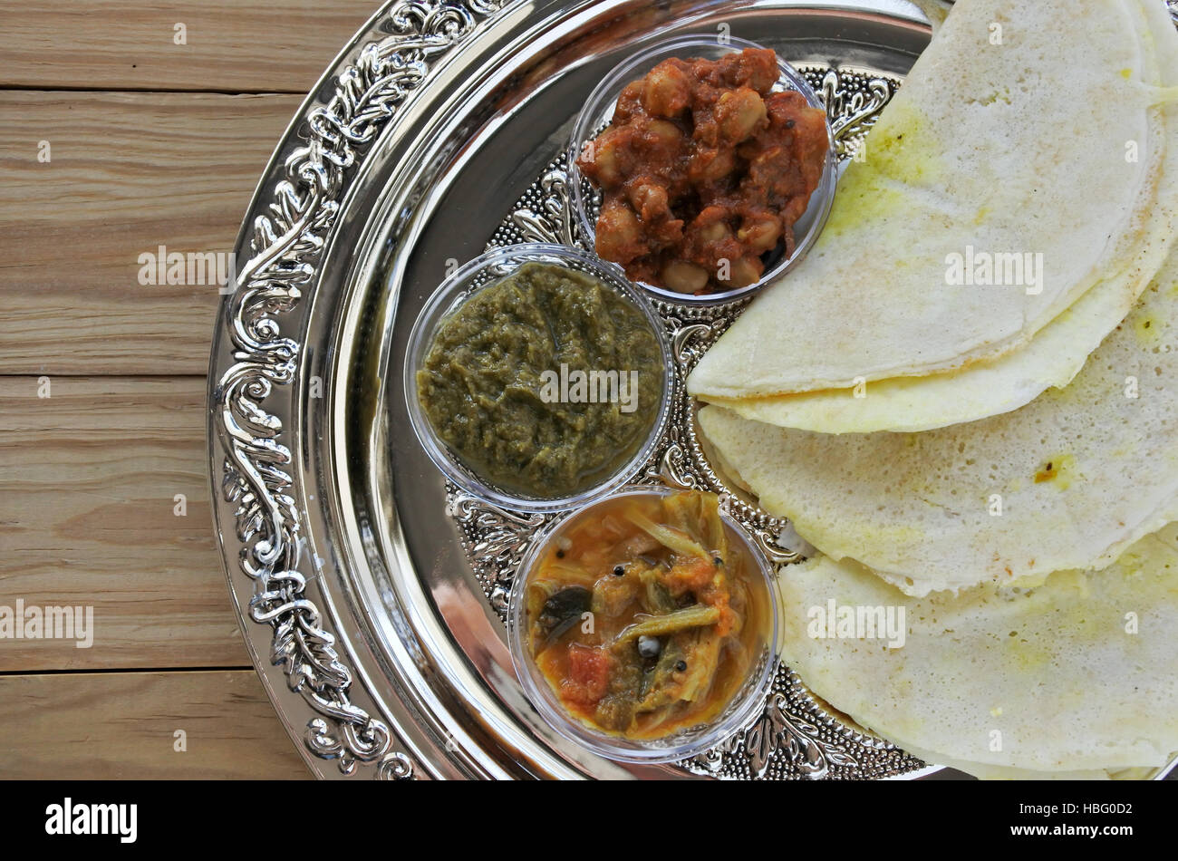 Flat lay of Indian food, Masala Dosa with Sambar and Channa Masala. Food background and texture. copy space - Stock Image