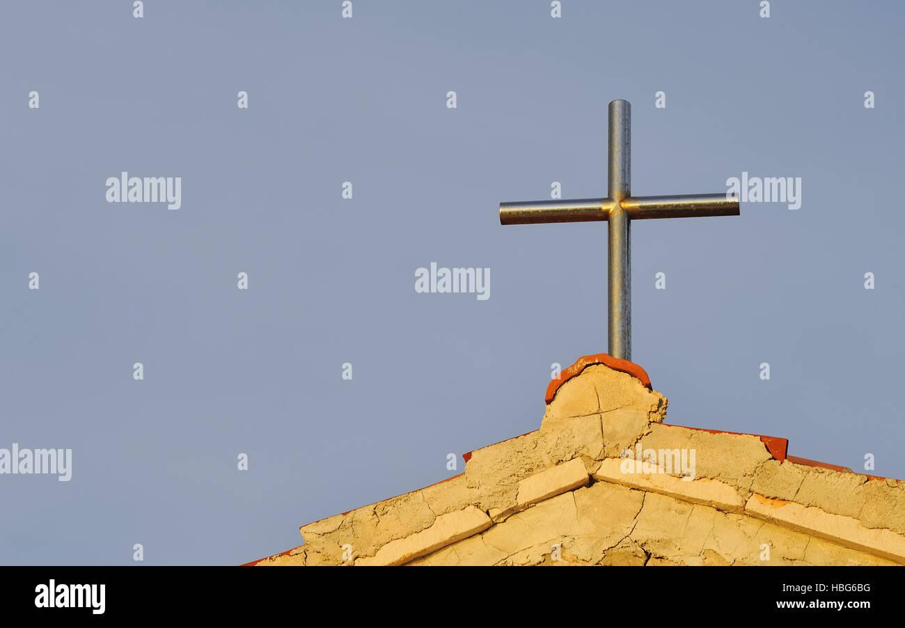 Metal cross on a chapel - Stock Image