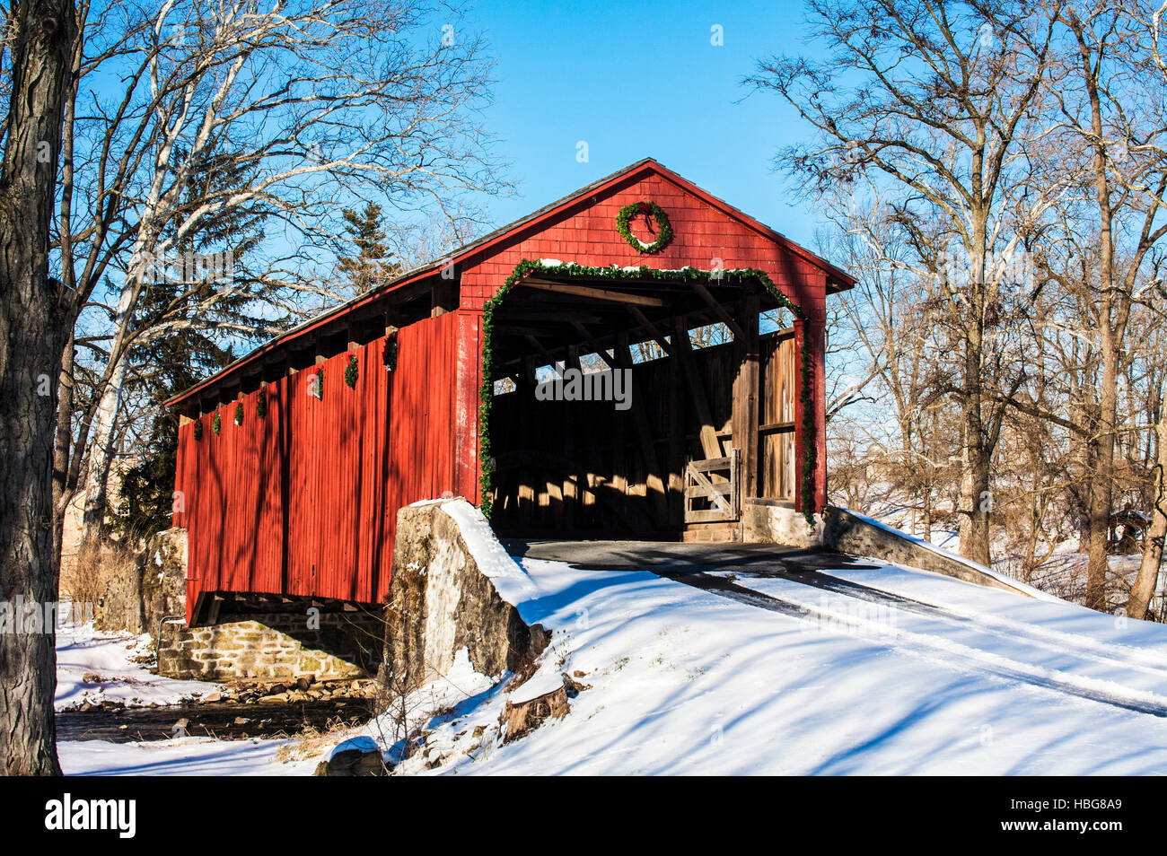pool forge covered bridge with christmas decorations in the amish country of lancaster county pennsylvania usa rural america concept