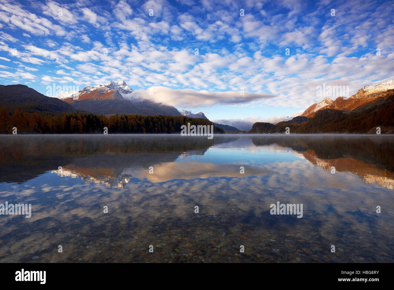 Cloudy sky, Lake Sils, Piz da la Margna behind, Sils, Engadin, Canton of Grisons, Switzerland - Stock Image