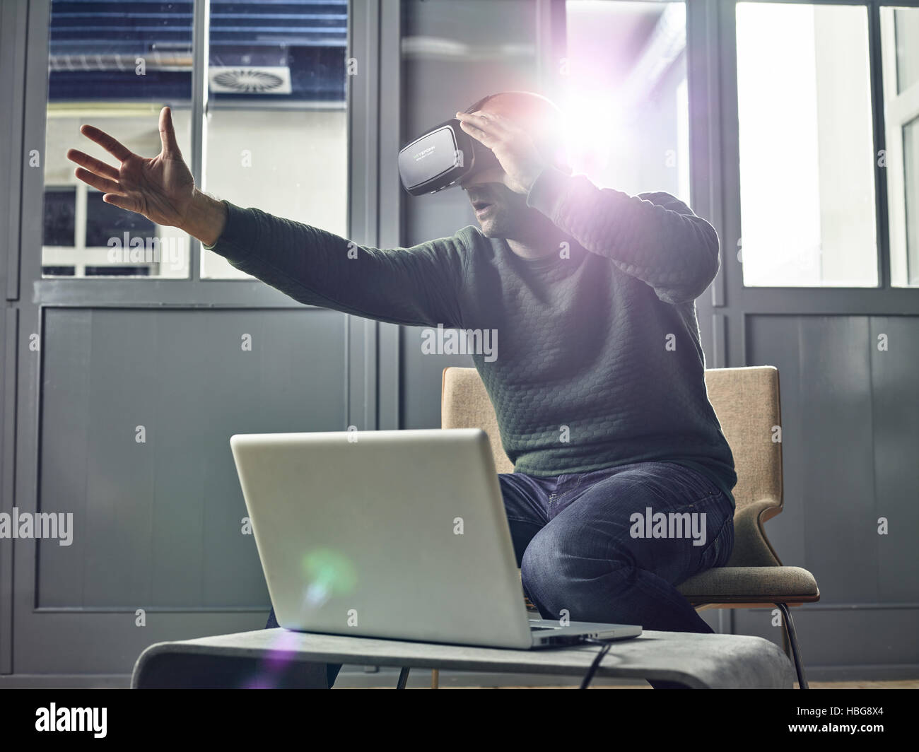 Man with VR goggles, virtual reality glasses - Stock Image
