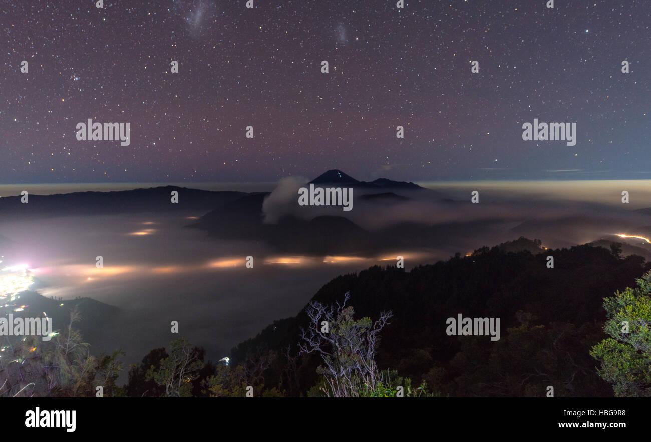 Night sky, stars, smoking volcano, Gunung Bromo, Mount Batok, Mount Kursi, Mount Semeru, Bromo Tengger Semeru National - Stock Image
