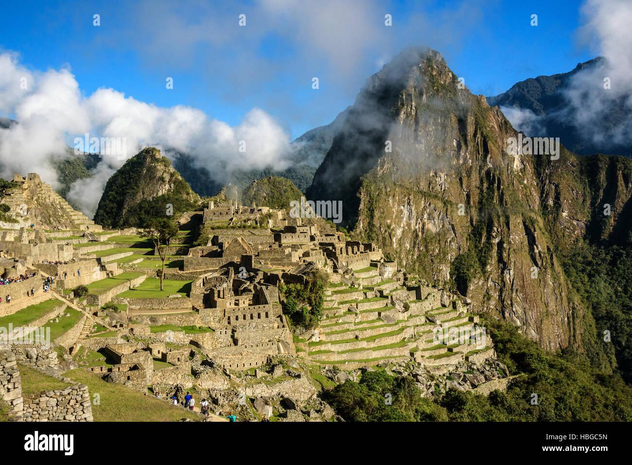 View of the Lost Incan City of Machu Picchu with clouds near Cusco, Peru. Machu Picchu is a Peruvian Historical - Stock Image