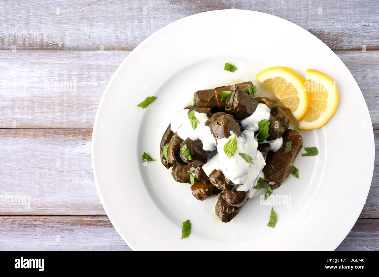 Flat lay of a plate of Yaprak sarma or Dolma  from the Turkish cuisine. Food background and texture. copy space - Stock Image
