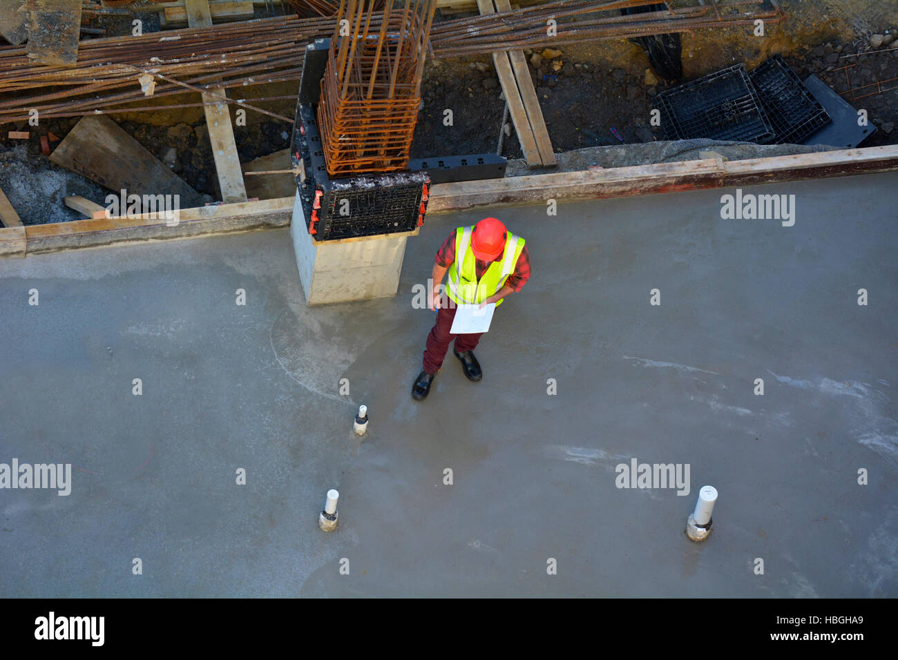 Aerial view of a foreman builder inspecting concrete construction. Copy space - Stock Image
