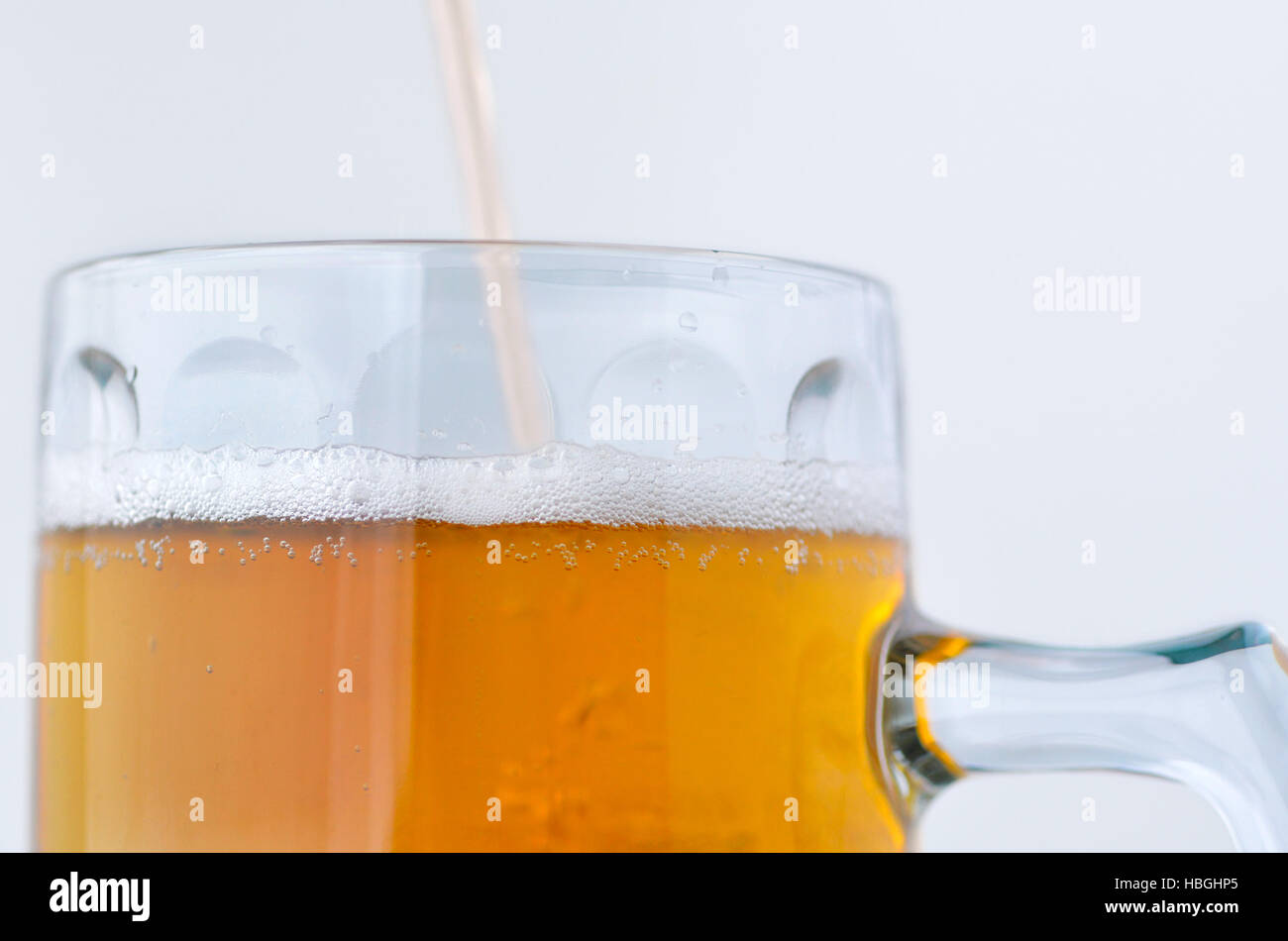 Personal point of view of a person pouring beer into a mug. Food and drinks background.Alcohol consumption concept. - Stock Image
