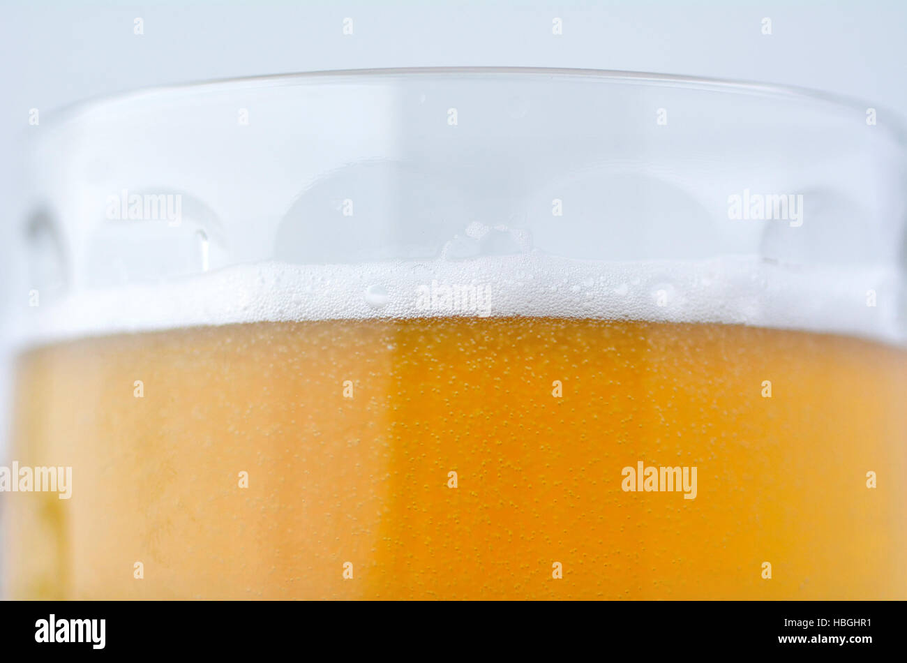 Detail of beer in a mug. Food and drinks background. Alcohol consumption concept. copy space - Stock Image