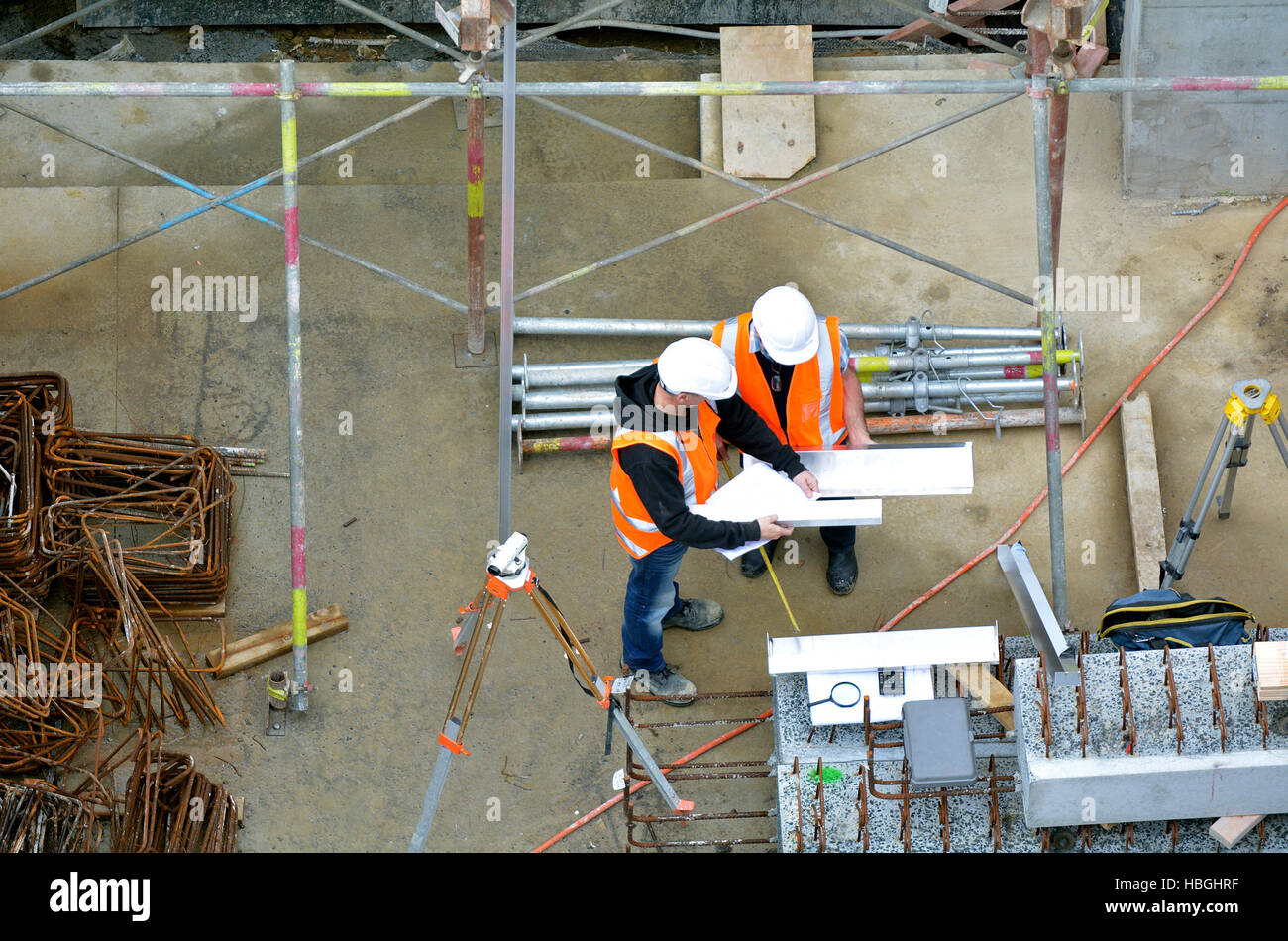 Aerial view of two unrecognized civil engineers inspecting construction site. Building development concept. - Stock Image