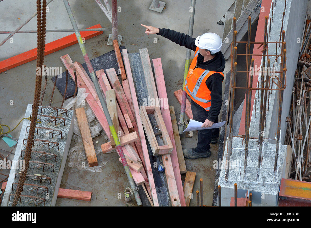 Aerial view of unrecognized civil engineers inspecting the work progress in a construction site. Building development Stock Photo