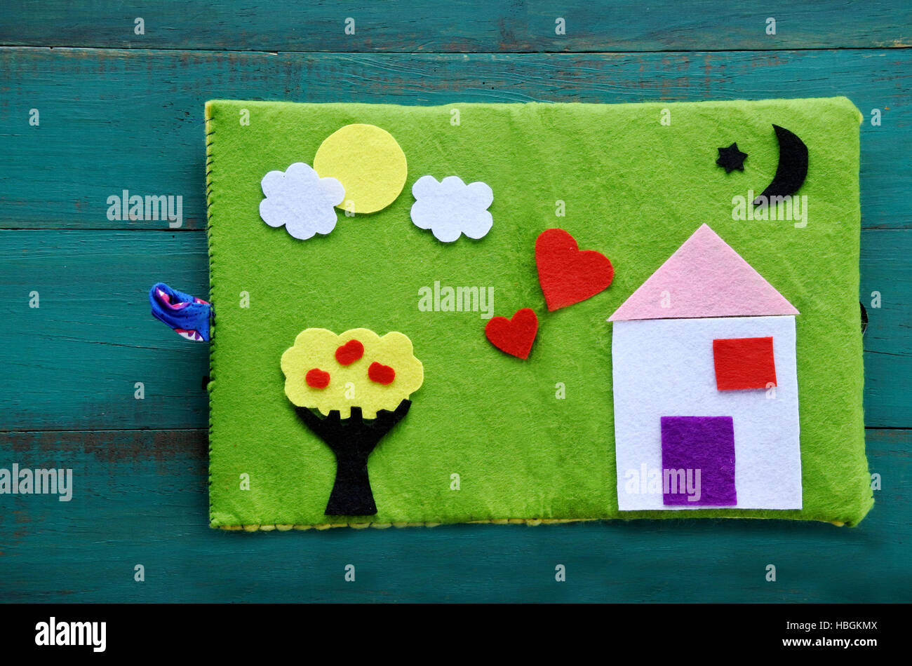 Flat lay view of handmade Felt Creations - Quiet Book. Happy family home concept. copy space - Stock Image