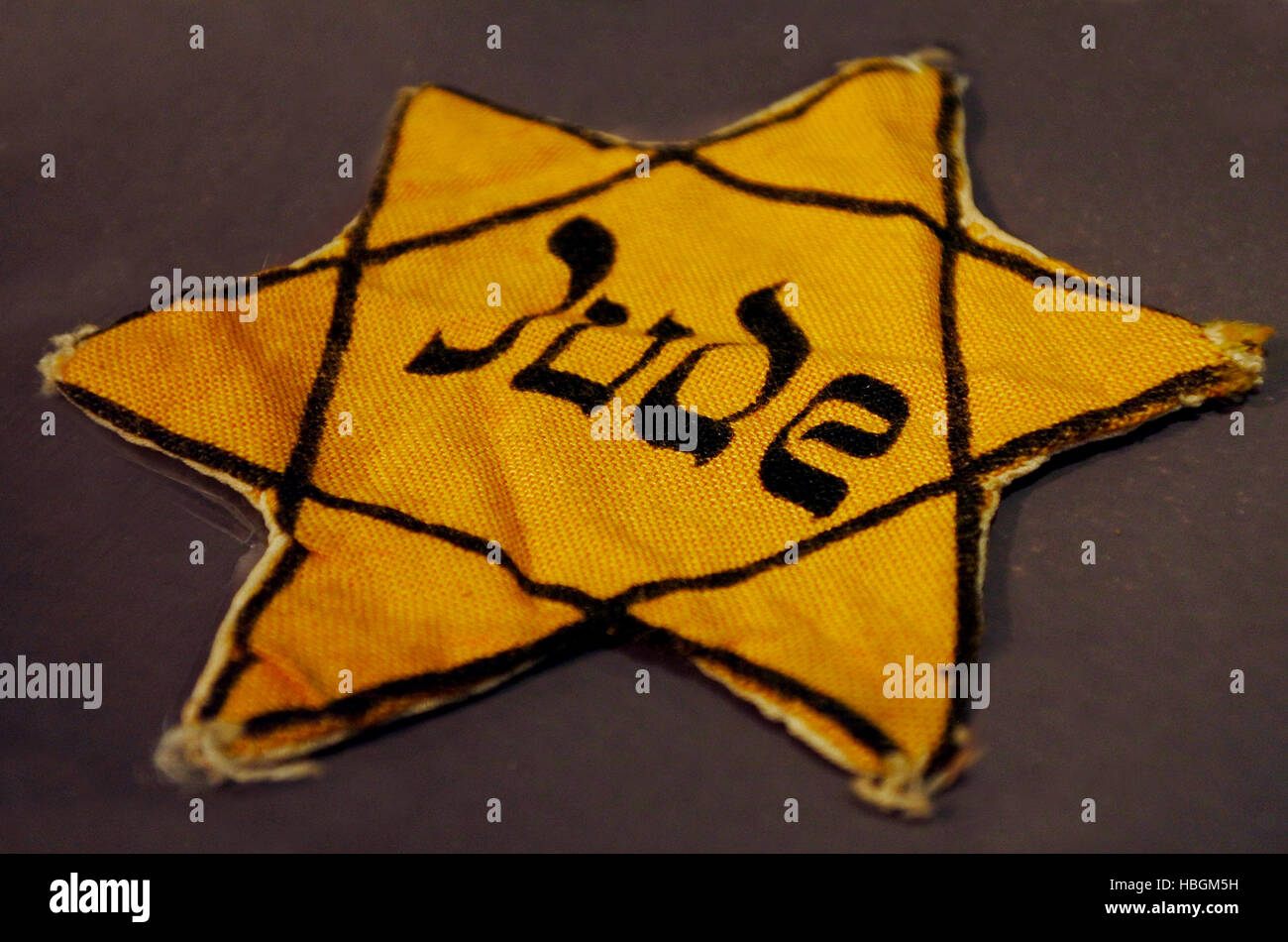 Yellow Jewish badge of shame. - Stock Image