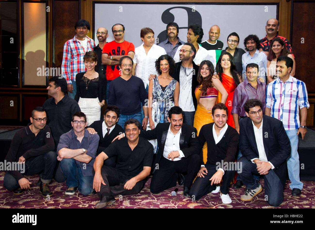 The entire cast and crew pose for a picture during the success party of their movie Delhi Belly in Mumbai, - Stock Image