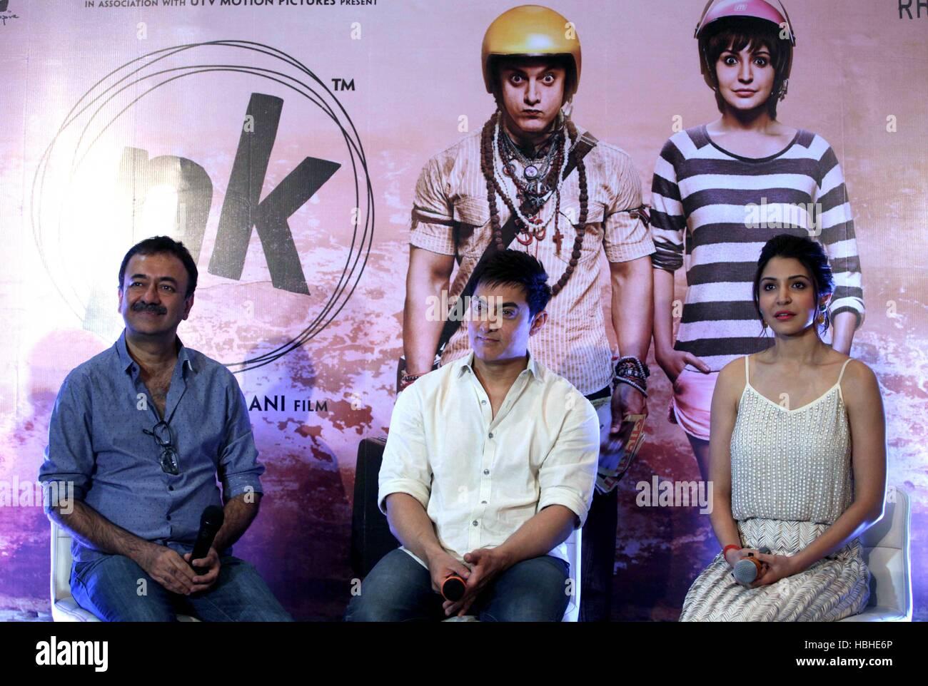 Bollywood filmmaker Rajkumar Hirani Aamir Khan Anushka Sharma during press conference to promote upcoming film PK - Stock Image