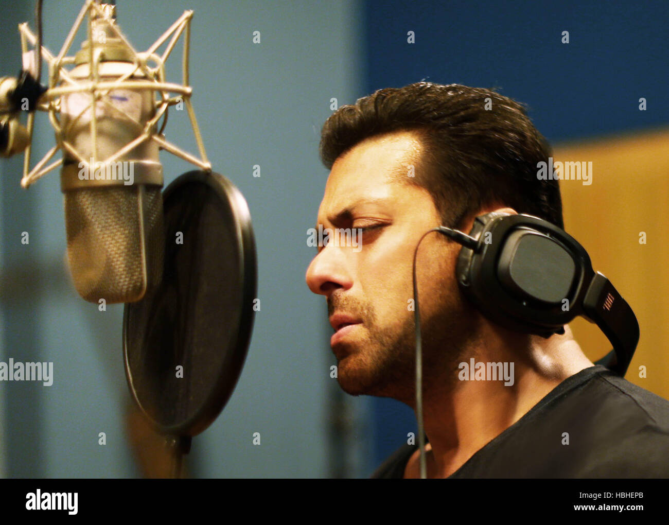 Bollywood actor Salman Khan sings the title track love song of his next home production 'Hero', in Mumbai, - Stock Image