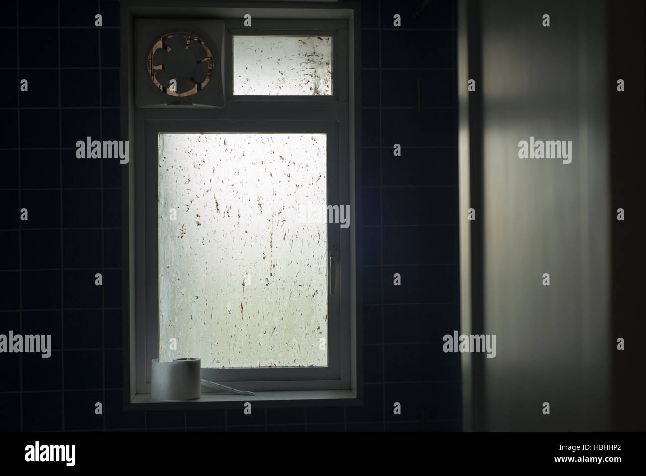 Toilet Paper On Window Sill With Exhaust Fan Stock Photo Alamy