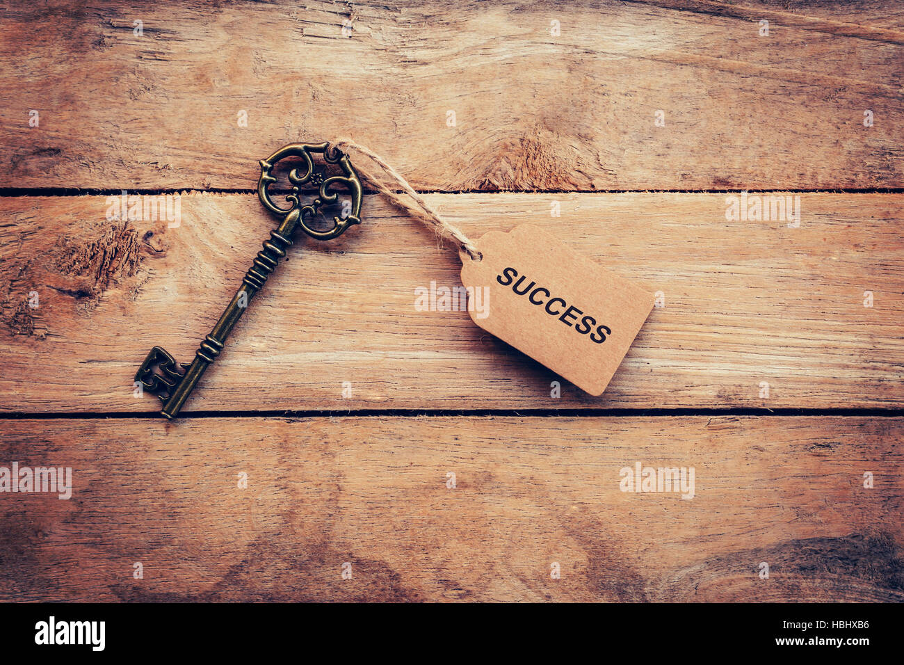 Business concept - Old key vintage on wood with tag Success. - Stock Image