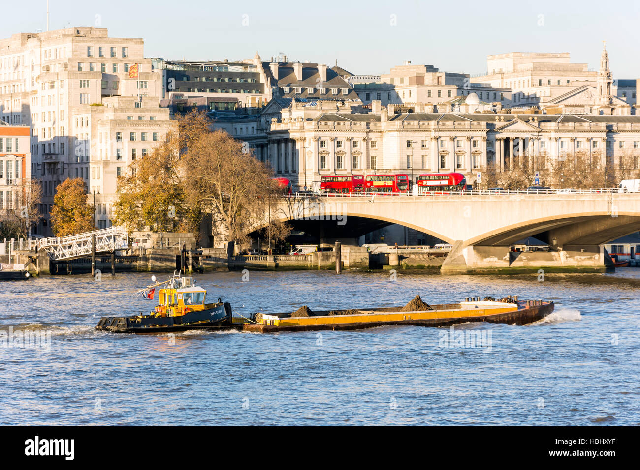 Tug boat steering barge on River Thames, South Bank, London Borough of Lambeth, Greater London, England, United - Stock Image