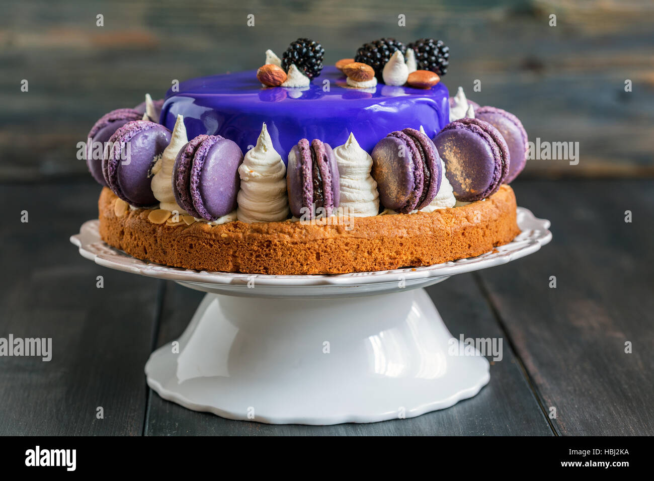 Mousse cake with a smooth colored glaze. - Stock Image