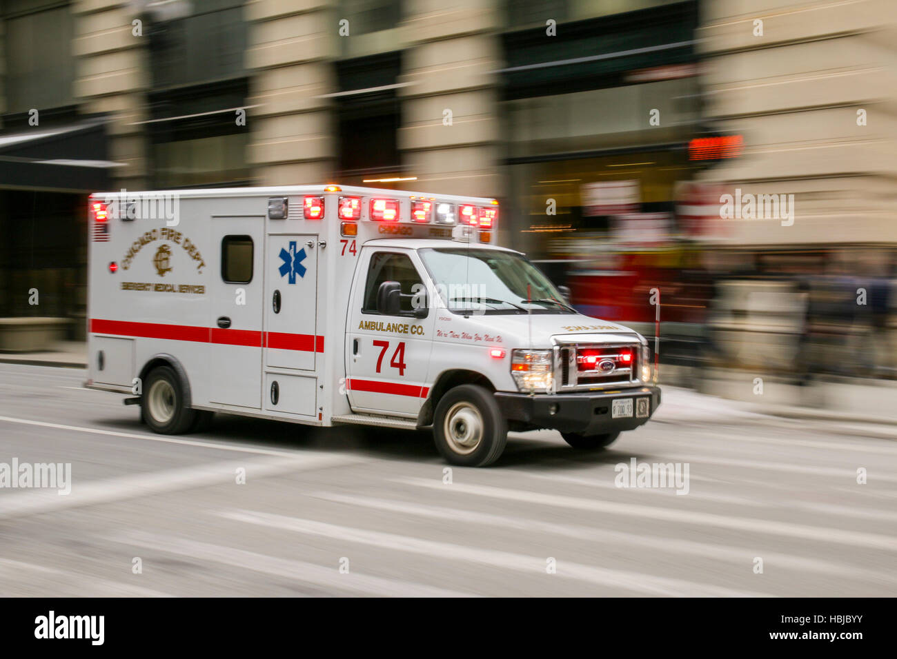 Chicago Fire Department ambulance in motion. - Stock Image