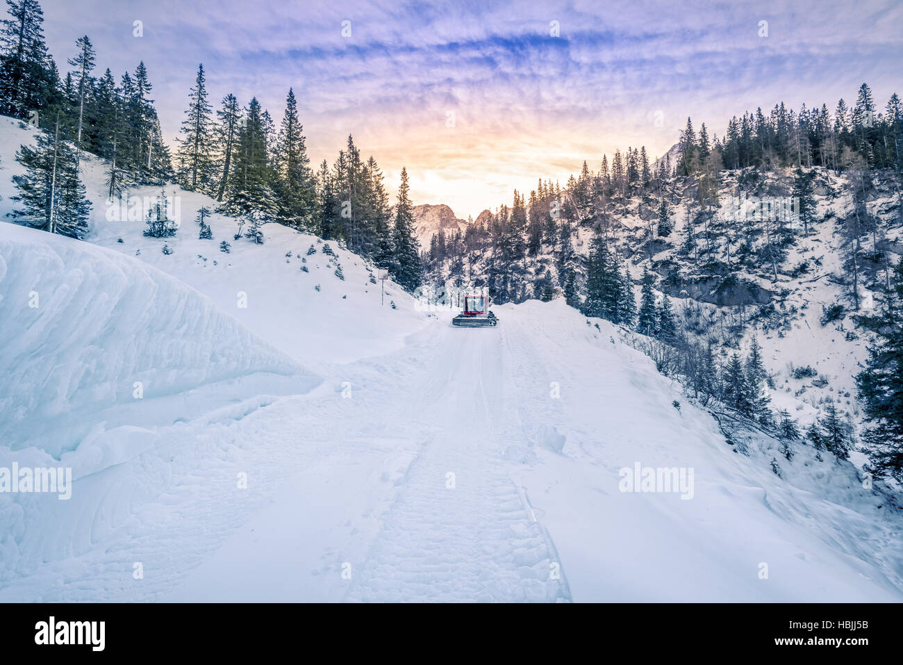 Alpine road mapped out in snow, Austria - Stock Image