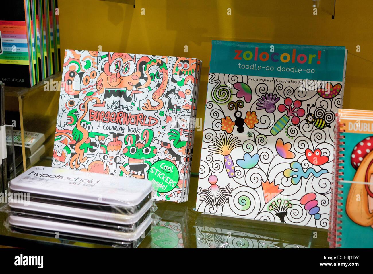 Children's coloring books on bookstore shelf - USA - Stock Image