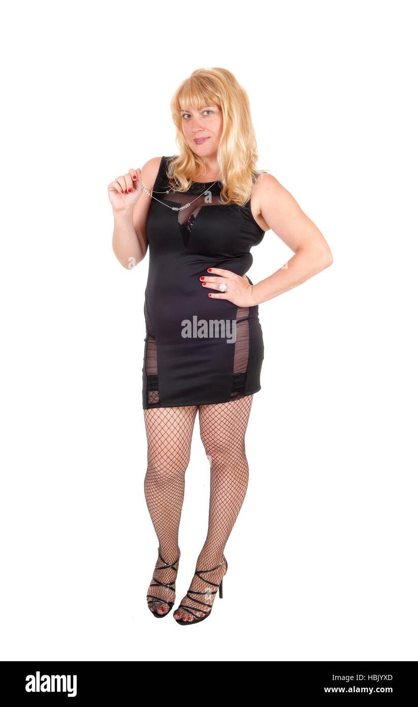 Woman in black dress and stockings. - Stock Image