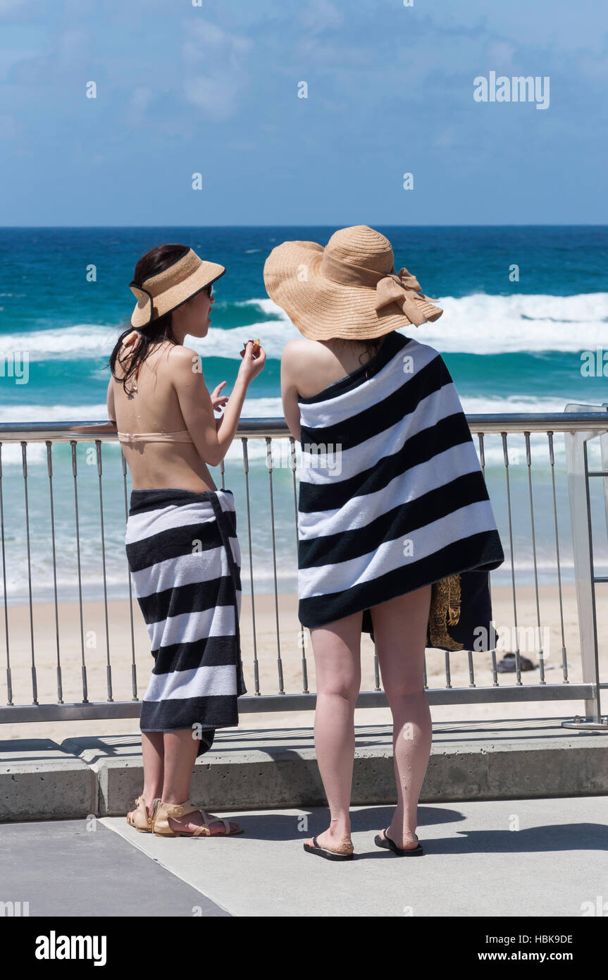 Young women in swimwear on The Esplanade, Surfers Paradise, City of Gold Coast, Queensland, Australia - Stock Image
