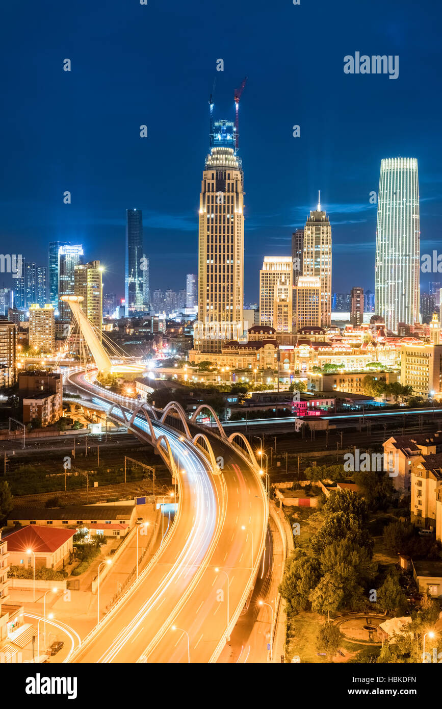 modern city at night in tianjin - Stock Image
