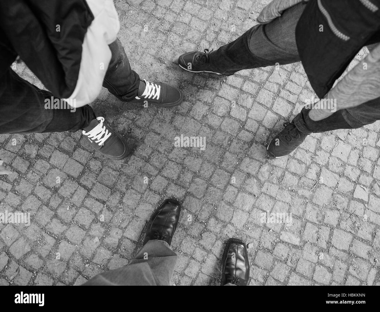 Three people feet in black and white - Stock Image