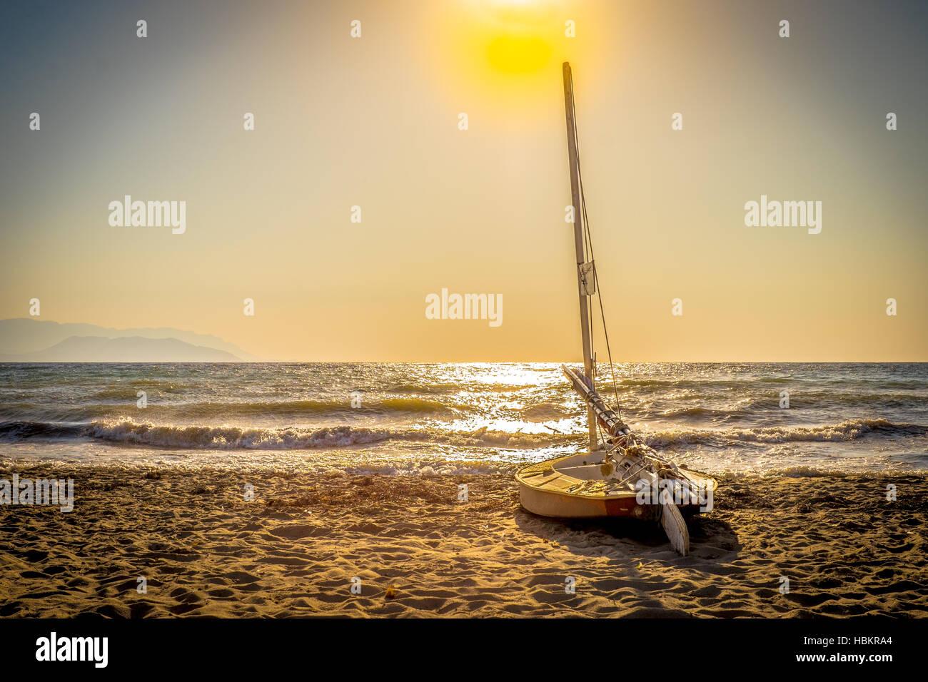 sailing bot, sun - Stock Image