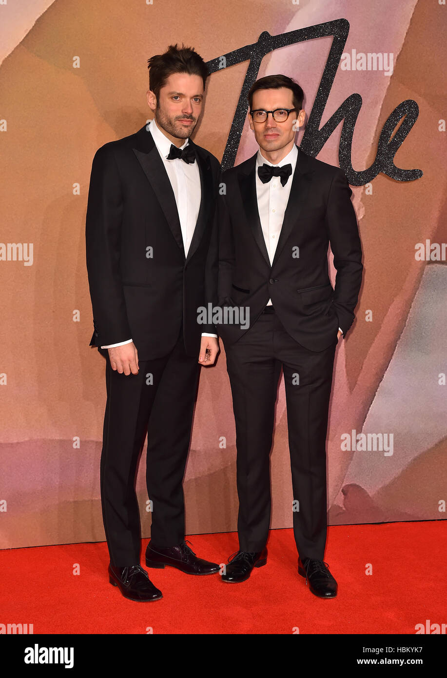 Guest and Erdem Moralioglu (right) attending The Fashion Awards 2016 at the Royal Albert Hall, London. PRESS ASSOCIATION - Stock Image