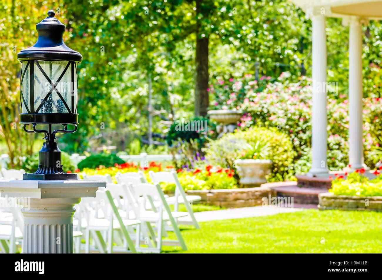 decorative classic lamp post in garden - Stock Image
