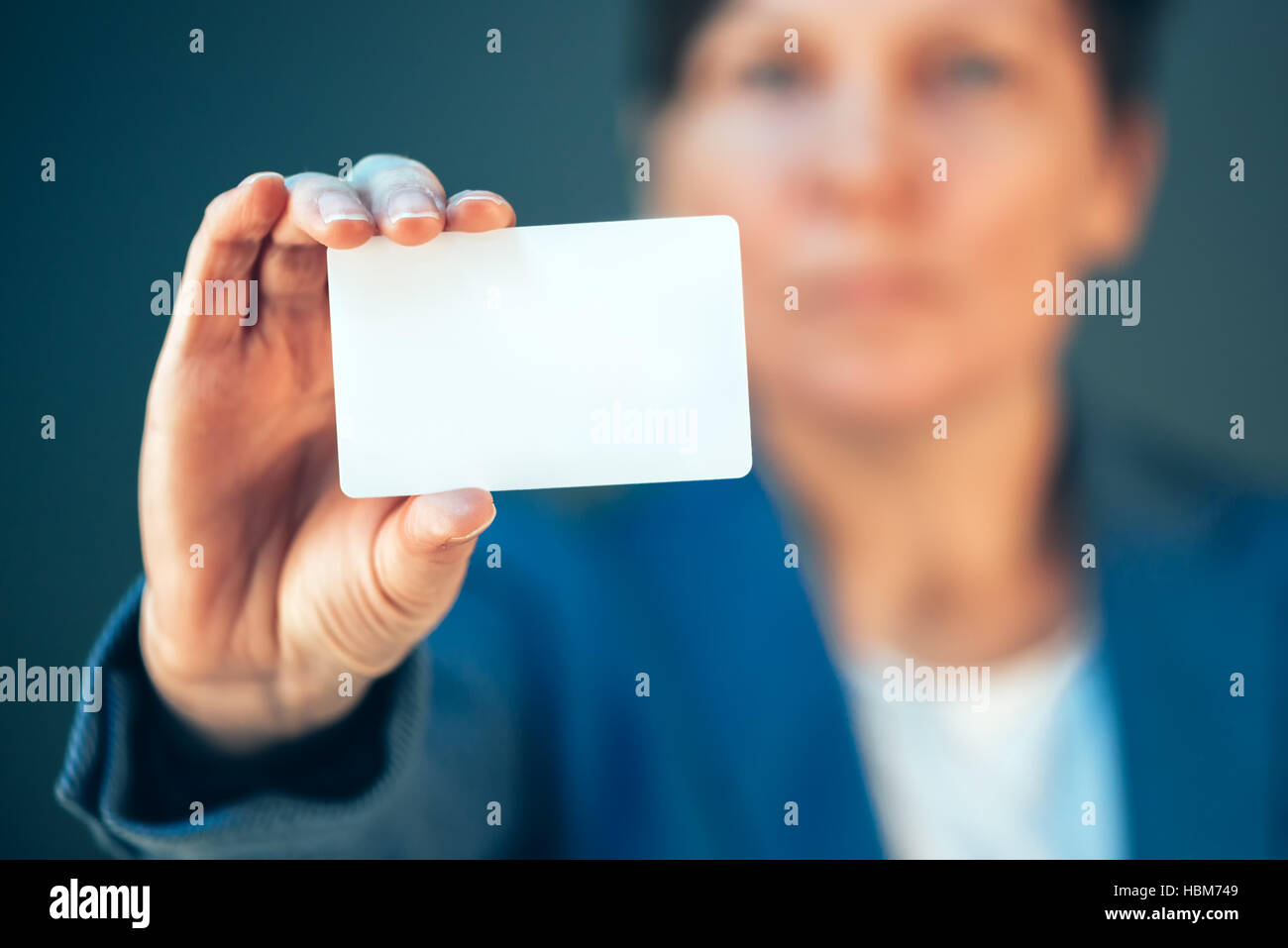Businesswoman holding blank business card as copy space for text or ...