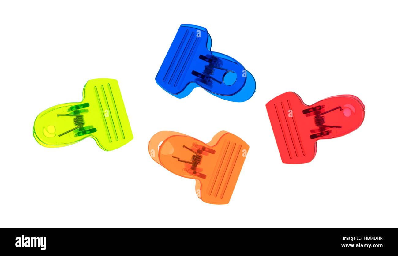 A group of colorful plastic clips isolated on a white background top view. - Stock Image