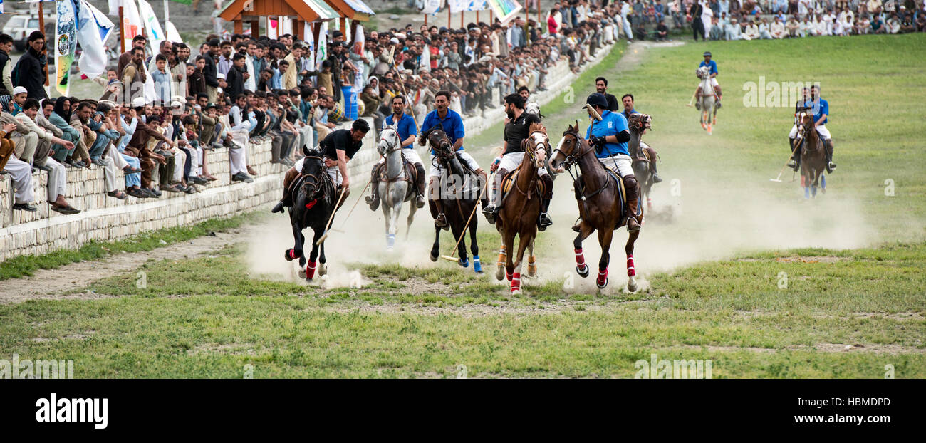 Free-style mountain polo being played on the Chitral Polo Ground. - Stock Image
