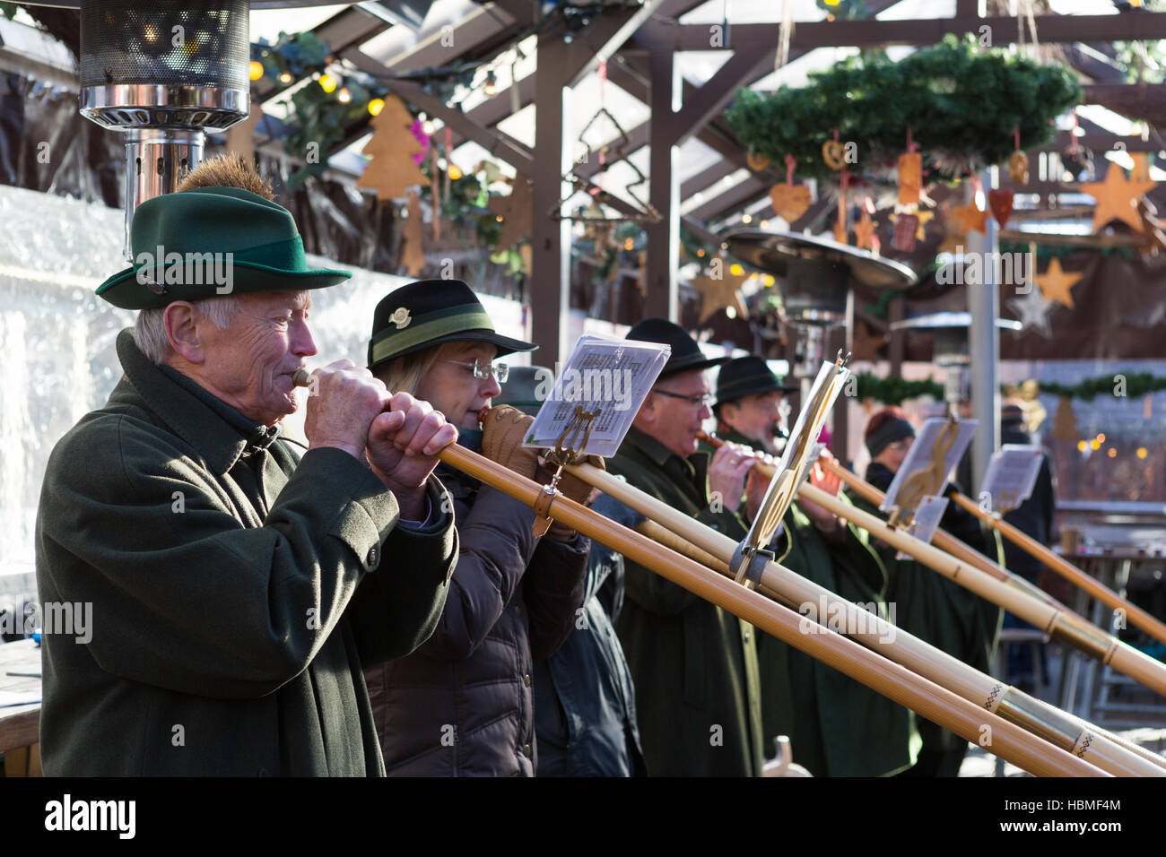 Musicians playing alphorns in Möchengladbach's Christmas market - Stock Image