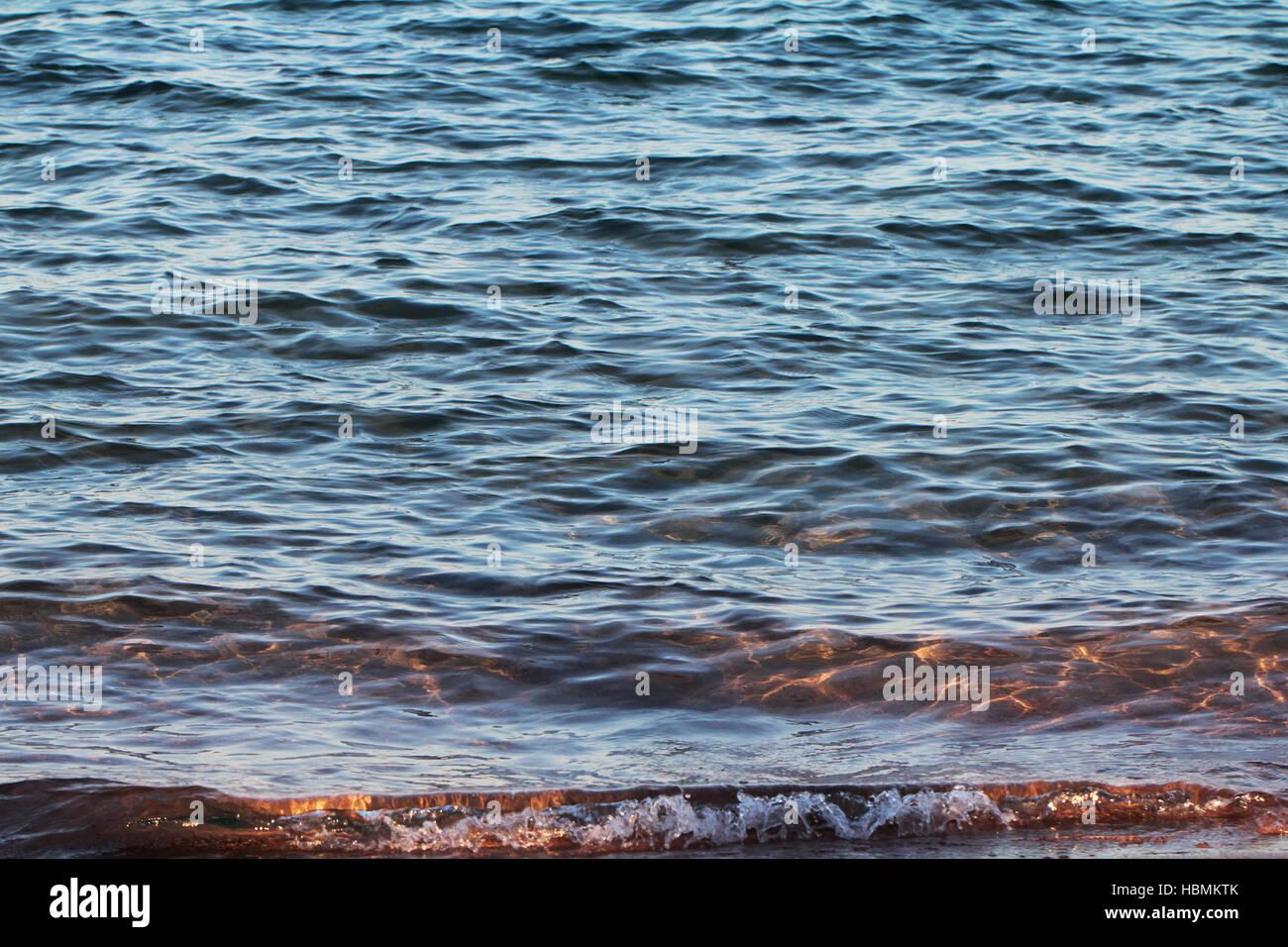 Sea waves on the beach Stock Photo