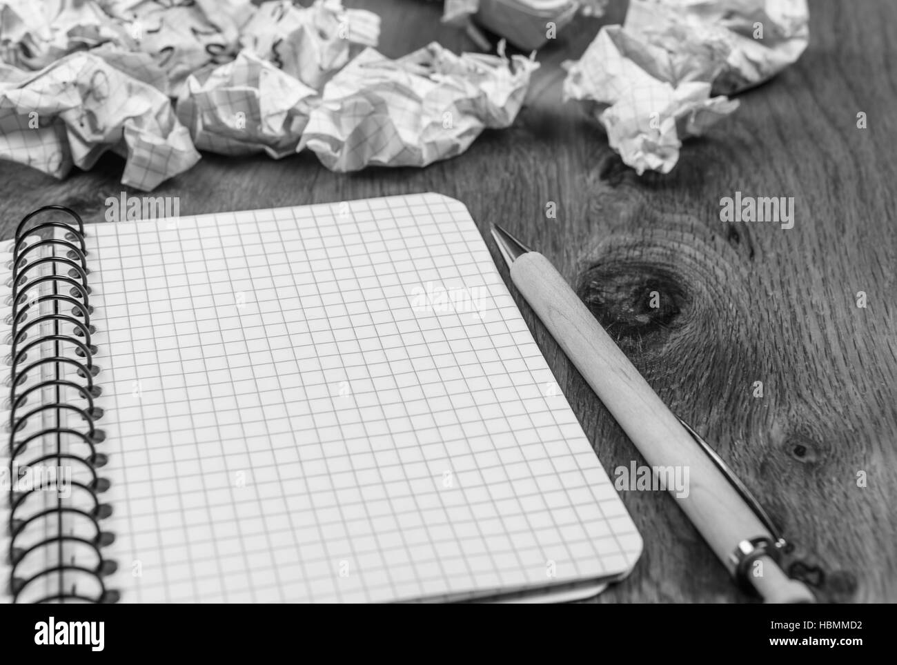 Spiral notebook and crumpled drafts - Stock Image