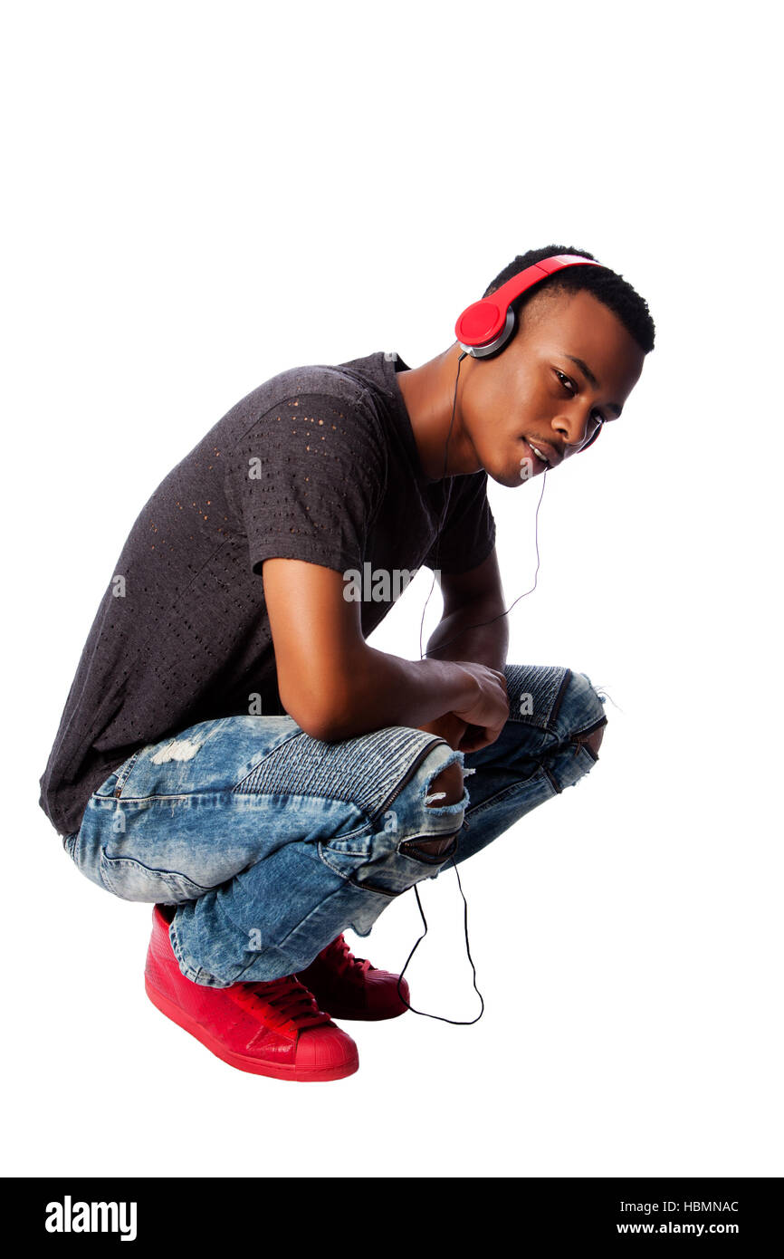 Handsome teenager listening to music Stock Photo